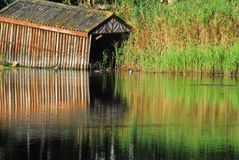 Africa- Beautifully Reflected Boat House on a River royalty free stock image