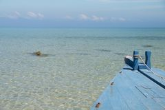 Beautiful scene, boat in the tropical sea with blue sky background.  royalty free stock image