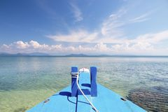 Beautiful scene, boat in the tropical sea with blue sky background.  stock photography