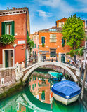 Beautiful scene with colorful houses and boats on a small channel in Venice, Italy Stock Images