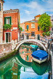 Beautiful scene with colorful houses and boats on a small channel in Venice, Italy Stock Image