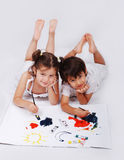 Beautiful scene of a girl and boy laying and playi Stock Photo