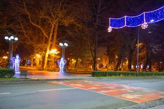Beautiful scene of Kutaisi in a New Year night. City night park in autumn with paths strewn. Central night street Royalty Free Stock Photos