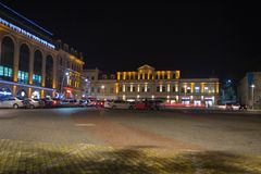 Beautiful scene of Kutaisi in a New Year night. City night park in autumn with paths strewn. Central night street Stock Image