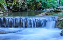 Beautiful scene of mountain waterfall with stone cascade in Serb. Ia, Europe, close up Royalty Free Stock Photo