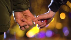 Beautiful scene of young couple in love holding hands stock video