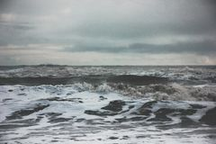 Beautiful scenery of amazing strong ocean waves during misty weather in the countryside. The beautiful scenery of amazing strong ocean waves during misty weather stock photography