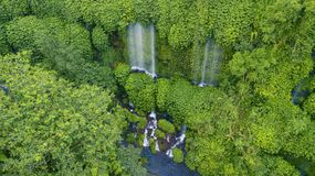 Beautiful scenery of Benang Kelambu waterfall. In the tropical forest in Lombok, Indonesia royalty free stock images