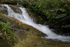 Beautiful scenery of cascaded river flowing through tropical rain forest Stock Photo