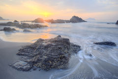 Beautiful scenery of dawning sky by rocky seashore in northern Taiwan Royalty Free Stock Image