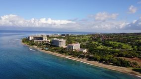 Beautiful scenery of the fashionable resort hyatt on the shore of ocean on island maui,hawaii. Wonderful aerial view of tropical nature and luxurious hotel hyatt stock video