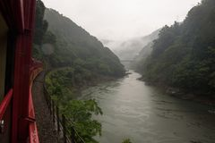Beautiful scenery of the Katsura river seen from the red wagons of the Sagano Scenic Railway. Kyoto, Japan royalty free stock photography