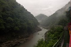 Beautiful scenery of the Katsura river seen from the red wagons of the Sagano Scenic Railway. Kyoto, Japan royalty free stock image