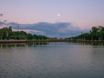 Beautiful scenery of lake and full moon in buriram, Thailand. Beautiful scenery of lake and full moon in a park in buriram, Thailand Royalty Free Stock Photos