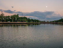 Beautiful scenery of lake and full moon in buriram, Thailand. Beautiful scenery of lake and full moon in a park in buriram, Thailand Royalty Free Stock Image