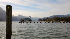 Beautiful scenery at lake Traunsee in Gmunden Upper Austria in spring vintage. Beautiful scenery at lake Traunsee in Gmunden Upper Austria in spring on a warm stock footage