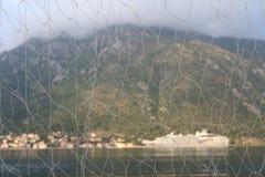 Beautiful scenery of Montenegro through the fishing net Stock Photo