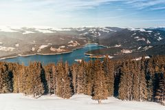 Beautiful scenery of mountain lake, high cliffs and trees. Beautiful scenery of mountain lake, snowy high cliffs and trees Stock Images