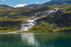 Beautiful scenery with mountain lake and waterfall. Mountain waterfall landscape. Beautiful scenery with mountain lake and waterfall. Mountain waterfall royalty free stock photo