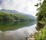 Beautiful scenery of the mountains and the lake. Beautiful morning landscape in the mountains and the lake with fresh air Stock Image