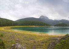 Beautiful scenery of the mountains and the lake. Beautiful morning landscape in the mountains and the lake with fresh air Stock Photography