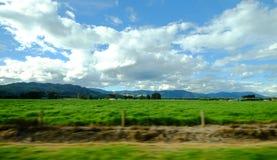 Mountain scenery in New Zealand. Beautiful scenery of mountains in New Zealand. View from running car window Stock Image
