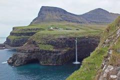Beautiful scenery of Mulafossur Waterfall and Gasadalur village Vagar island Faroe islands