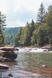 Beautiful scenery with river and riverside with stones at mountains Royalty Free Stock Image