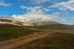 Beautiful scenery slopes of volcano Mutnovsky with clouds. Stock Images