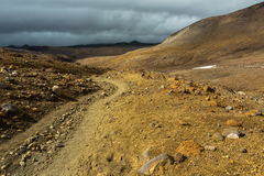 Beautiful scenery slopes of volcano Mutnovsky with clouds. Stock Image