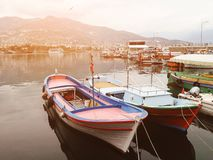 Beautiful scenery. Small boats stand in the port, in the background of the city and the mountains. Turkey stock photo