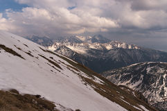 Beautiful scenery of spring snowy mountains.  Royalty Free Stock Images