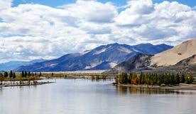 The beautiful scenery of the Tibetan plateau. The vision of the beautiful scenery of the Tibetan plateau mountains near the river Stock Image