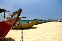Traditional fisherman boats on sandy beach. bright sunny day and blue sky background. Beautiful scenery, traditional fisherman boats on sandy beach. bright sunny Stock Photo