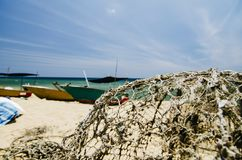 Traditional fisherman boats on sandy beach. bright sunny day and blue sky background. Beautiful scenery, traditional fisherman boats on sandy beach. bright sunny Royalty Free Stock Photography