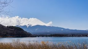 Beautiful scenery View of Mount Fuji at kawaguchiko, Japan in the sunny day with moving cloud. Lake kawaguchi is a very popular for tourists and photographers stock video footage