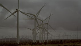 The beautiful scenery of windmills operating in the countryside stock footage