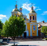 Beautiful scenery of the yellow Church on the background of blue sky Stock Images