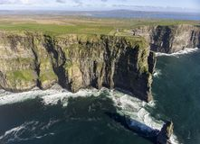 Beautiful Scenic Aerial drone view of Ireland Cliffs Of Moher in County Clare, Ireland. Stock Photos