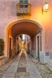 Beautiful scenic alley with historic and traditional houses and cobbled street stock photography