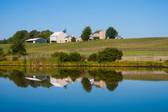Beautiful scenic barn reflects in mirror like pond Royalty Free Stock Photo