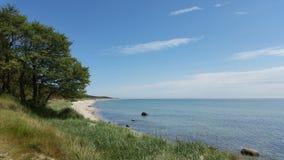 Beautiful scenic sandy beach, blue water,  clear blue sky, Island Bornholm Denmark Royalty Free Stock Photos