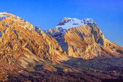 Free Beautiful Scenic Golden Autumn Landscape Of Fisht Mountain Peak At Sunset Under Blue Sky, West Caucasus, Russia Royalty Free Stock Image - 126951856
