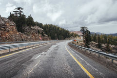 Beautiful scenic highway in mountains. Car rides on asphalt surf Royalty Free Stock Photos