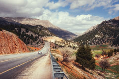 Beautiful scenic highway in mountains. Car rides on asphalt surf Stock Photo