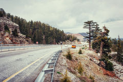 Beautiful scenic highway in mountains. Car rides on asphalt surf Royalty Free Stock Photo