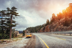 Beautiful scenic highway in mountains. Car rides on asphalt surf Royalty Free Stock Image