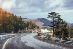 Beautiful scenic highway in mountains. Car rides on asphalt surf Stock Photography
