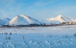 Beautiful scenic landscape with snow covered mountains and fir trees, kolyma highway,. Russian federation stock photos