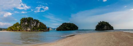 Beautiful scenic limestone island in Krabi, Thailand long panorama. Limestone cliff in Krabi, Thailand. Beautiful paradise view scenic coastline Phi Phi stock photos